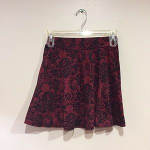 red skirt with black lace detailing